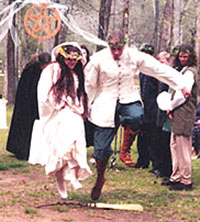 Catholicpagan witch wedding jump the broom old pagan wedding ritual at the altar stand within a circle drawn beforehand or the brides attendees can draw a circle around the couple junglespirit Image collections